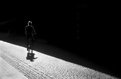 Light rider 2 (Olderhvit) Tags: street light shadow blackandwhite lumix gothenburg streetphotography panasonic streetphoto minimalism goteborg 2015 gatufoto 1020076 framingthestreet olderhvit dmcgx7