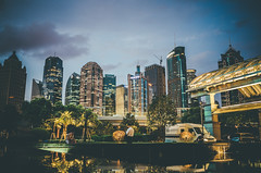 Lujiazui_2 (hans-johnson) Tags: china road street blue sky urban orange building tower architecture night skyscraper asia shanghai 28mm gr 中国 上海 pudong 陆家嘴 ricoh ricohgr jinmao jinmaotower 金茂大厦 lujiazui 东方明珠 浦东 大厦