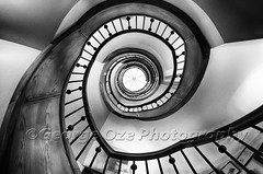 Wooden Staircase Perspective (George Oze) Tags: travel horizontal architecture germany de spiral hotel europe steps perspective nobody landmark historic staircase quaint hospitality circular multistory fineartphotography blackdress geometricshapes diminishingperspective lowangleview reinbek buildingexteriors waldhausrenbek