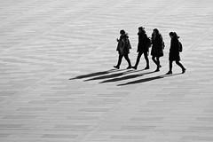 Shadowy Figures (Mondmann) Tags: shadows women walkingwomen walking pedestrians bw pb nationalmuseumofkorea museum seoul korea southkorea rok republicofkorea asia eastasia contrast mondant fujuifilmxt10