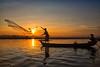 catching early rays~ Myanmar (~mimo~) Tags: asia burma documentary mimokhairphotography myanmar travel sunrise net fisherman sun light outdoor beauty boat woman hat people
