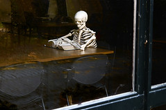 Skeleton reading book in the library (Sergey_pro) Tags: book skeleton dead vertebrae studying library chest window table chair male medicine bone biology spinal body skull student joint anatomy exhausted education background health man reading skeletal isolated human hip natural white medical femur biological torso rib care standing science backbone tired spine horror death anatomical scary han