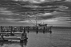 _40A6819 B&W (ChefeGrande) Tags: texas marina shrimpboats sunrise blackandwhite monochrome jetty docked boat clouds outdoor saltlife seashore seaside water gulfcoast southtexas bw