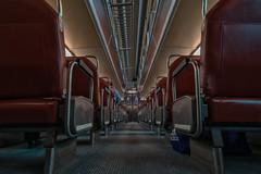 Red Cart Metra Train Interior (Jovan Jimenez) Tags: red cart metra train interior sony ilce 6500 emount a6500 alpha 12mm f28 zeiss touit carl seats public transit transportation chicago rta