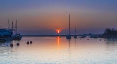 Red Streak (nicklucas2) Tags: seascape christchurch quay sun sunrise boat yacht