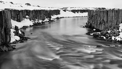 Welcome to Volcanic Wonderland (lunaryuna) Tags: iceland northeasticeland jökulsááfjöllumriver rivergorge rivercanyon columnarbasalt volcanicland betweendettifossandselffoss nature landscape rockface rockformations geologicalformations beauty wildriver spring season seasonalchange snowedin blackwhite bw monochrome panoramicviews lunaryuna