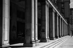 2015_07_02003 (octo fish) Tags: 35mm bw film hp5 kiev2a poland warsaw architecture stalinist figure urban columns warszawa