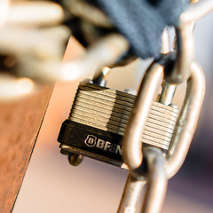 Macro Mondays - The space in between (Lee Chu) Tags: macromondays project365 sel35f18 sonynex6 toronto ontario canada padlock chain orange goldenhour