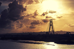 新北大橋日落 - New Taipei Bridge sunset - TAIWAN (urbaguilera) Tags: park city travel bridge sunset summer sky sun tourism water skyline clouds river landscape concrete nikon traffic riverside wind outdoor horizon taiwan tranquility cable structure taipei 日落 臺灣 typhoon 天空 stayed 鳥 danshui 颱風 淡水河 夏天 金色 云海 臺北 大橋 danielaguilera 新北市 newtaipeicity urbaguilera