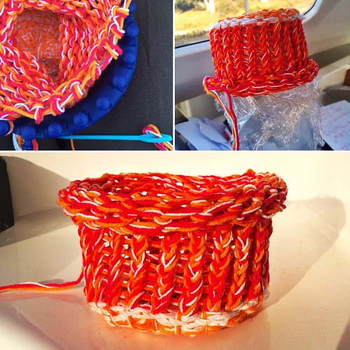 267/365 • I was very inspired by the beautiful baskets made by @poa_and_pod when we stayed at her house, and I wondered if I could make my own little 'basket' using my smallest circle loom. I used white, orange and hot pink cotton. When I finished it was