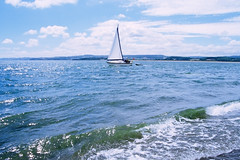 (verityxrose) Tags: ocean uk blue light sea summer england sky sunlight white holiday green film beach water clouds 35mm boat seaside movement shore exmouth