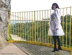 Maggie in Plastic (Mistress Maggie dot com) Tags: plastic transparent seethru coat mac mackintosh rainwear pvc belted lady woman female standing view mature glasses bridge cliftonsuspensionbridge waterproof raincoat shiny outdoors fetish seethrough