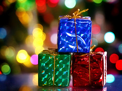 Three Little Gifts... 🎁🎁🎁 HMM (Through Serena's Lens) Tags: mm macromondays holidaybokeh gifts presents small macro holiday stilllife reflection colorful bokeh decorations lights ornaments stacked christmas decoration ornament stack