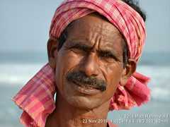 2016-11b Orissa's Ethnic Mosaic (18) (Matt Hahnewald) Tags: red primelens portrait street beach cultural character respect travel fisherman male adult teeth posing authentic moustache checkered manly fishingvillage eyes matthahnewaldphotography face facingtheworld headscarf horizontal head india indian morning nikond3100 orissa outdoor puri 50mm expression headshot nikkorafs50mmf18g clarity fullfaceview 1200x900pixels resized colour person 4x3ratio closeup consensual lookingatcamera