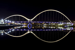 Illuminated Symetry (devil=inside) Tags: night nocturnal illuminated lights bridge reflections water river structure architecture teesside hand photography sony a77 infinity