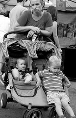 Mom's frustration (tvdflickr) Tags: boys festival georgia children 50mm nikon df stroller f14 candid mother streetphotography tired males marietta frown fatigue disappointment disgust mariettageorgia nikondf photosbytomdriggers photobytomdriggers thomasdriggersphotography