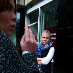 Pariah (Luxifurus) Tags: street woman girl cigarette candid cellphone smoking frown smoker hipshot