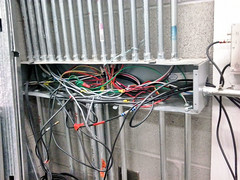 Electric Rat's Nest (Eyellgeteven) Tags: building electric wall danger cord dangerous wire mess wiring box cords wires electricity electrical twisted conduit tangled connections junctionbox ratsnest loosewire loosewires eyellgeteven