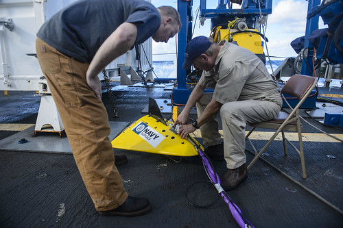 Personnel aboard USNS Apache prepare to search for the missing motor vessel M/V El Faro.