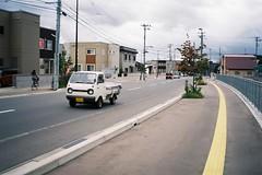 K-TORA in city (しまむー) Tags: fuji minolta f56 f28 80mm c200 38mm mactele