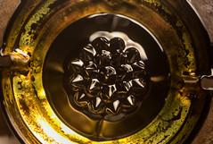 Golden bowl (ferrofluid 2) (scyrene) Tags: white black yellow metal gold magnet bottlecap focusstack ferrofluid heliconfocus