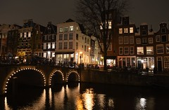 Herengracht Canal, Amsterdam, Netherlands (fame&obscurity) Tags: bridge houses holland reflection tree water netherlands amsterdam lights canal arch bikes arches canals bicycles oldhouses amsterdamcanal herrengracht herrengrachtcanal