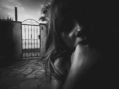 The cry of child (dono heneman) Tags: cry cri scream child enfant children portrait noiretblanc nb blackwhite ciel sky nuage cloud plage beach portail portillon gate jardin garden route road pierre stone cambrils catalogne espagne olympus tg850