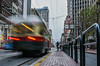 teenager transport (pbo31) Tags: sanfrancisco nikon d810 california boury pbo31 january 2017 winter city urban bayarea color lightstream motion traffic motionblur muni streetcar marketstreet infinity downtown island transit busstop financialdistrict teenagers girls