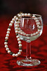Pearls are always appropriate. (Through Serena's Lens) Tags: pearl necklace jewelry glass bokeh stilllife tabletop tablecloth red reflection