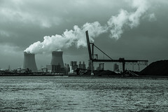 crane and chimneys (Jan Herremans) Tags: janherremans belgium port antwerpen antwerp nuclear plant crane landscape bw mono smoke energy schelde