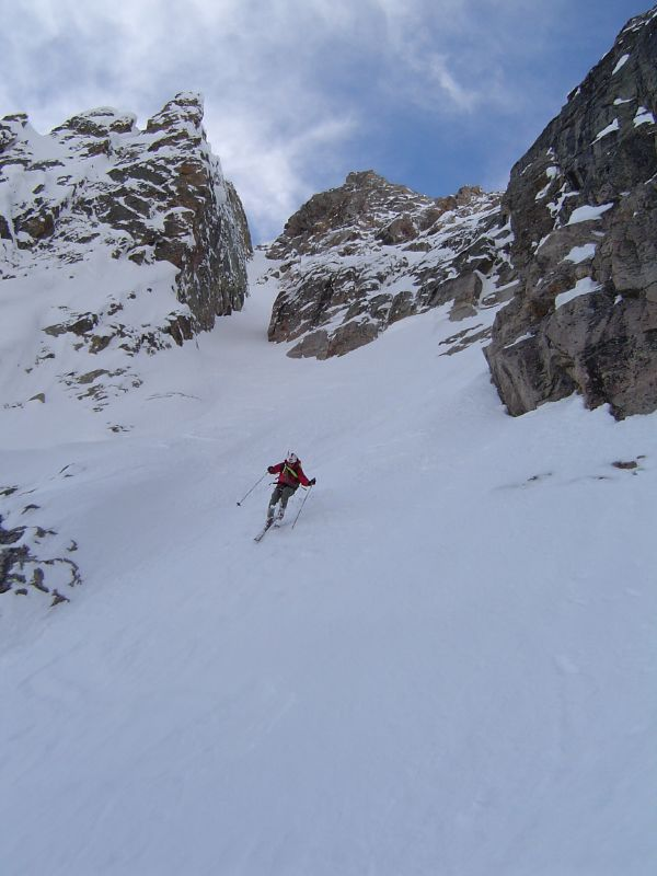 Reed skis below the Hidden Couloir