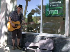 (Sheila Steele) Tags: dylan freeassociation downtown guitar ryan xsrjx saskatoon busker canadatrust guitarcase sheilasteele secondavenue frizztext