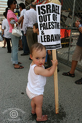 Palestinian Baby  Holding Protest Sign (IndyFoto) Tags: copyright lebanon usa baby signs toronto canada against children dawn bush war rally protest 2006 christian demonstration stop arab linda american murder jew bombs harper hammond israeli bombing gaza placards consulate palestinians deaths antizionist indyfoto blackribbonicon thebestofday gnneniyisi