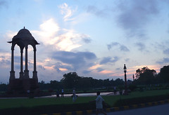 Sunrise at India Gate (suz kosh) Tags: morning sky india monument nature beauty architecture sunrise asia outdoor empty delhi lamppost health walker silhoutte emperor kinggeorge indiagate