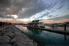 Calm befor the Storm (Ammar Alothman) Tags: city winter sunset sky orange storm cold color clouds marina mall landscape interesting fantastic nikon flickr ship gulf calendar d70s dream 2006 calm explore fantasy kuwait souq ammar marinamall kuwaitcity kw q8  sigma1020  ammaralothman 3mmar  salmeya marinaport kuwaitvoluntaryworkcenter