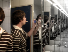 Mirror Action (C_MC_FL) Tags: camera portrait color colour photoshop self canon photography mirror photo fotografie cigarette spiegel smoking ixus wc repetition restroom fade clone effect effekt zigarette rauchen repeating lokal 750 wiederholen