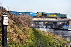 Eighty Two Miles From Shardlow (whosoever2) Tags: trent mersey canal freightliner class66 66595 6j34 lostockgralam cheshire northwich train railway railroad signpost bridge water nikon d7100 december 2016 england unitedkingdom uk gb greatbritain