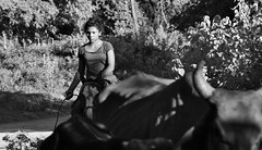 real life (TazNoMore) Tags: blackandwhite bw horse girl cattle cows riding nicaragua horseback herding