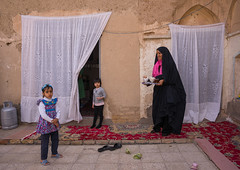 an afghan refugee mother with her daughters in their home courtyard, Isfahan Province, Kashan, Iran (Eric Lafforgue) Tags: poverty girls people afghanistan horizontal children outdoors war iran refugee muslim curtain poor daughter mother middleeast social courtyard afghan conflict kashan foodanddrink immigrant clandestine migrant displaced 3people socialissues threepeople persiangulfstates lookingatcamera إيران humanitarianism fulllenght иран 16611 colourimage イラン irão isfahanprovince preteengirls 伊朗 westernasia 이란 afghaniculture