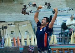 iranian man training with kabbadeh chain and bow at saheb a zaman club zurkhaneh, Yazd Province, Yazd, Iran (Eric Lafforgue) Tags: portrait people man male men sport horizontal training persian chains athletic adult iran muslim performance middleeast persia bodybuilding chain indoors bow shia ritual tradition activity kashan sufi sufism cultures oneperson yazd zurkhaneh shiite practising midadultman waterreservoir exercising 30sadult persiangulfstates traditionalsport إيران onlymen onemanonly waistup иран 16060 colourimage 1people イラン zourkhaneh irão abanbar isfahanprovince 伊朗 zurkhane yazdprovince muscularbuild westernasia houseofstrength kabbadeh 이란 gowd kabade