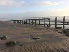 Remains of an old wooden 'groyne' on Aldingham beach. (Bennydorm) Tags: clouds sky january iphone5s remains timbers aldingham europe uk britain england cumbria furness morecambebay coast seaside barrier breakwater wooden sands shore beach groyne