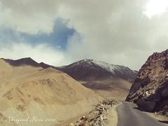 Mystical Path (Shrayansh Faria Photography) Tags: sky cloudscape mountains roughterrain rugged barren altitude path sand nature landscape hardrock rocks snow snowclad peak