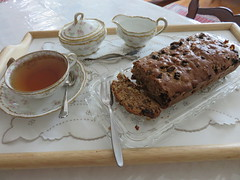 Boiled Raisin Cake Loaf and tea. China: Haviland (Traveling with Simone) Tags: morning roses food cake breakfast canon recipe cuisine yummy tea napkin fork indoor spoon romance sugar celebration delicious patisserie homemade meal tray romantic festivity teacup doily gateau kuchen breakfastinbed aroma canonpowershot mahlzeit romantique nachspeise leckereien sugartongs bthisisreallyanstunningphotobbdeservesawardfromstunningphotogroupbbrbabrahrefhttpswwwflickrcomgroups2723367n24titlefromsirgawinsbysirgawinsonflickrimgsrchttpsfarm8staticflickrcom7528159 onflickrstunningphotoab boiledraisins
