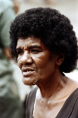 28-294 (ndpa / s. lundeen, archivist) Tags: city portrait people man color film face fiji 35mm candid nick citylife streetphotography streetlife suva whiskers southpacific 28 1970s 1972 curlyhair toothless dewolf missingteeth oceania localpeople fijian pacificislands nickdewolf photographbynickdewolf reel28