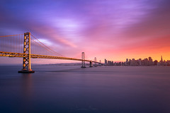 Sunset City (_JonathanMitchellPhotography_) Tags: sanfrancisco california longexposure bridge blue winter sunset art water northerncalifornia yellow clouds print boats photography gold bay march media artist cityscape treasureisland sony wideangle burn baybridge bayarea eastbay waterscape burningclouds sunsetphotography a7r sanfranciscophotography