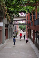 And They Are Off (michael.veltman) Tags: seattle kids running pedestrian street washington