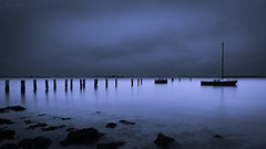 Blue Moonlight (JDS Fine Art & Fashion Photography) Tags: ocean sea boat beach rocks moonlight night romantic atmosphere blue dreamy calm serenity peaceful inspirational