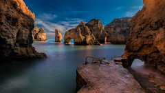 Enchanted Cove (Adam West Photography) Tags: adamwest algarve arches cove lagos landing mercy pirate point pontadapiedade portugal sky stacks timelapse cliffs clouds limestone rocks sea rockpaper