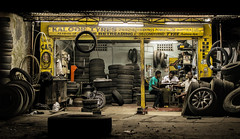 Workshop (relishedmonkey) Tags: nikon d5300 35mm 18g tyres india kerala vyttila cars automotive auto mechanical workshop work people men three together surrounded parts