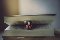 189/365 Nightly Escapades (Katrina Y) Tags: book bookhangover surrealphotography conceptual manipulation tiny miniature selfportrait 365project 2017 artsy creative mood light flashlight reading worm